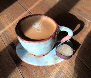 The end product - a cup of coffee with a slice of marzipan on the saucer