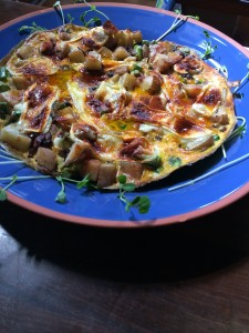 Serving the frittata on a pretty blue plate
