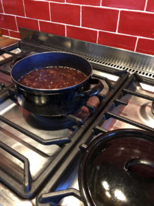 Plums in heavy pot on stove, early in the cook