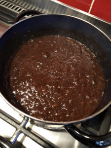 Plums in heavy pot on stove, a bit later in the cook - more reduced, thicker consistency